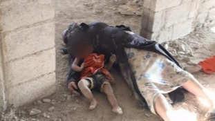 A mother and child lie dead in the Damascus suburb of Zamalka