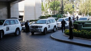 A convoy carrying UN weapons inspectors arrives at a Damascus hotel on 18 August