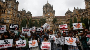 ournalists hold placards as they participate in a protest march in Mumbai.