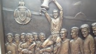 Relief on plinth of Nat Lofthouse memorial at Reekbok Stadium