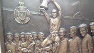 Relief on plinth of Nat Lofthouse memorial at Reekbok Stadium