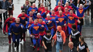 Fans dressed in Superman outfits arrive at Wembley