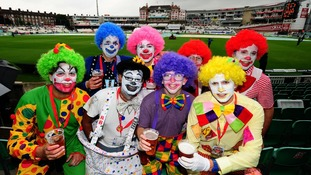 Fans dressed as clowns