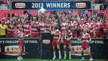 Wigan Warriors celebrate with the trophy after winning the Challenge Cup Final at Wembley Stadium, London.