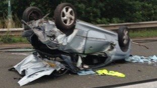 Two women were travelling in this car when it crashed with two others and ended up on its roof