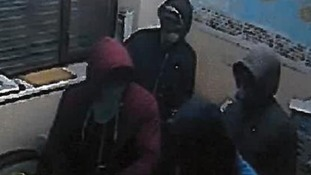 The four masked men pictured inside the Willenhall business premises