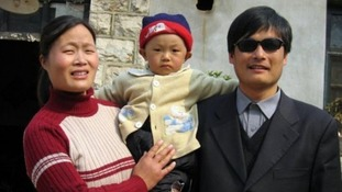 Chen Guangcheng with his wife and one of their children.