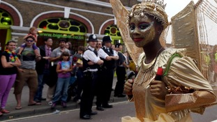 Carnival goer parades through Notting Hill