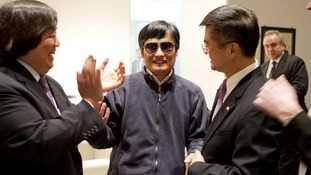 US Ambassador to  China Gary Locke, right, with Chen Guangcheng, at the US embassy in Beijing, yesterday.