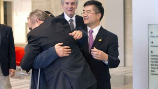Assistant Secretary Campbell embraces Chen Guangcheng at the US embassy in Beijing yesterday.