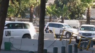 Cars carrying UN inspectors return to their hotel in Damascus
