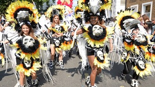 Carnival performers don skull costumes in Notting Hill