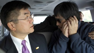 US Ambassador to China Gary Locke with Chen Guangcheng at the US embassy in Beijing