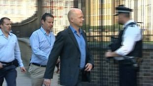 Foreign Secretary William Hague walking into the back entrance to Number 10
