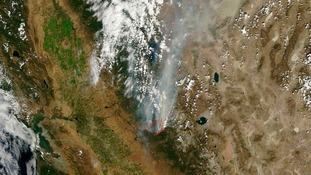A satellite image of the drought-fueled Rim Fire near Yosemite National Park
