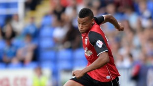 Ipswich Town defender Tyrone Mings has signed a new contract to stay at Portman Road