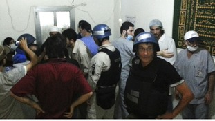 UN chemical weapons experts visit a hospital in Damascus yesterday after the suspected attack.