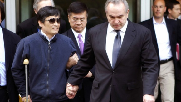Chen Guangcheng (2nd L) being accompanied by U.S. Assistant Secretary of State for East Asian and Pacific Affairs Kurt Campbell (front R)