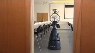 Linda the robot patrolling an empty science lab
