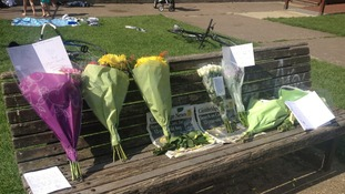 Flowers left by the River Cam to pay tribute to Andy Collings.