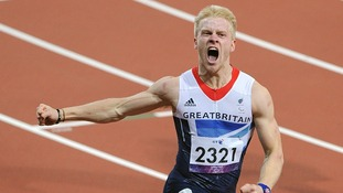 Great Britain's Jonnie Peacock celebrates as he crosses the line to win the Men's 100m - T44 Final, during the Paralympic Games in London.