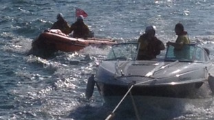Boat being towed by lifeboat