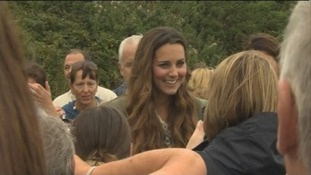 The Duchess of Cambridge smiles as she chat to locals.