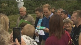Prince William is given a present t help him with changing Prince George's nappies.