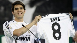 Brazilian footballer Kaka holds his new Real Madrid jersey in 2009