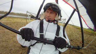Putin sits in a motorised deltaplane after guiding cranes to new migration routes