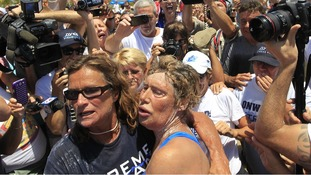 Diana Nyad collapses into her friend's arms as she completes her 110-mile journey.
