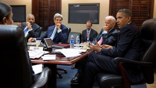 President Barack Obama discussing the situation in Syria with his National Security Staff in the White House