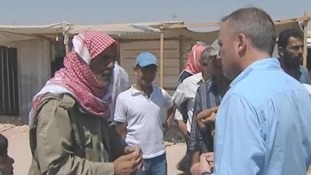 A Syrian refugee in Zaatari camp in Jordan talks to our correspondent