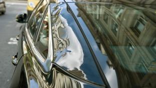 Side of Jaguar XJ on Eastcheap warped by the heat