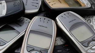 Old Nokia phones piled up.