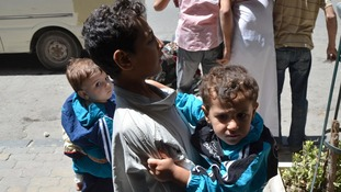 Children affected by an alleged chemical attack in Damascus