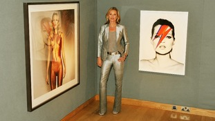 Kate Moss poses in front of works by Allen Jones (left) and Nick Knight (right)