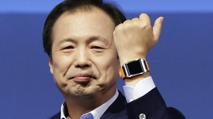 Shin Jong-kyun, President and CEO, head of IT and Mobile Communication division of Samsung presents the Galaxy Gear smart watch.