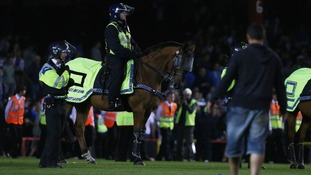 Mounted police respond to a pitch invasion at Ashton Gate, Bristol