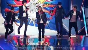 One Direction perform during the 2013 Brit Awards at the O2 Arena, London