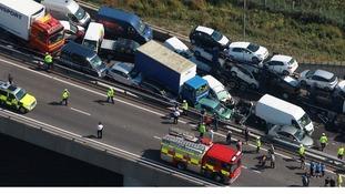 Emergency services swarm across the bridge after the crash.