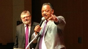 Civil rights activist Rev Jesse Jackson has arrived to rapturous applause