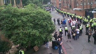 Police and protesters on Queen Elizabeth Street.