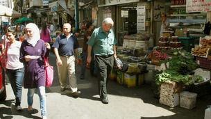 Syrians shop at a market in Damascus.