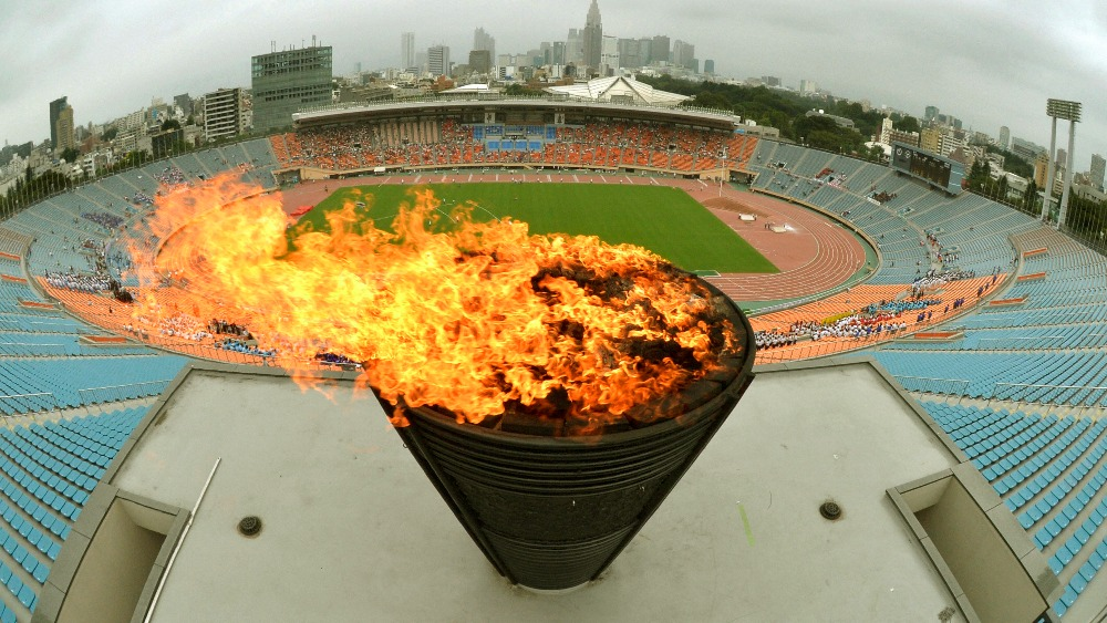 1964 Olympic flame relit at national Stadium in Tokyo ...