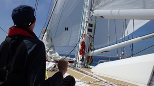 Slowly releasing the spinnaker sail