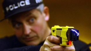 Policemen with taser