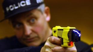Policemen with taser