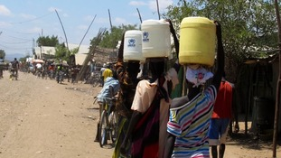 People in the Kakuma refugee camp, in the north west of Kenya, carry water.