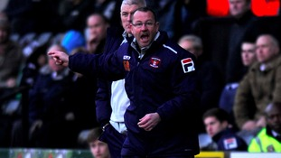 Greg Abbott shouts instructions from the sideline as Carlisle took on Notts County in March.